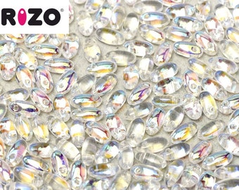 Rizo® Crystal AB, 10 grams, 2.5 x 6mm, 2 inch hanging tube, approx 150 beads