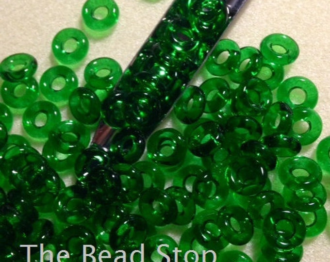 """Featured listing image: CRYSOLITE GREEN Czech Glass Rings Donuts 10mm, 25 pcs, clear 3"""" hanging tube"""