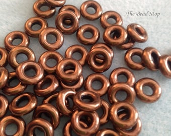"""Jet Bronze Czech Glass Rings Donuts 10mm,25 pcs, clear 3"""" hanging tube"""
