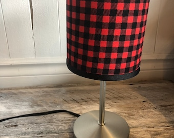 """Small red and black plaid pattern desk lamp. height 12 """"circumference 5"""". Lampshade fabric that provides a diffuse light"""