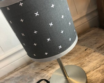 "Small dark pattern X white/grey desk lamp. height 12 ""circumference 5"". Lampshade fabric that provides a diffuse light"