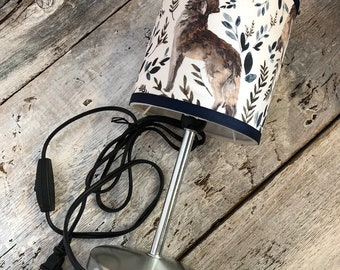 "Small pattern wolves desk lamp. height 12 ""diameter 5"". Lampshade fabric that provides a diffuse and decorative lighting"