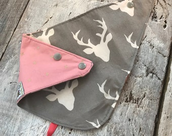 reversible and waterproof bandana bib, deers heads and gold X on pink