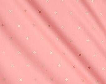 Gold X on pink baby fitted sheet for crib