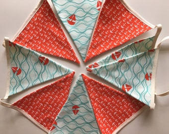 Seaside bunting with anchors and boats in orange, blue and white fabric with 9 flags