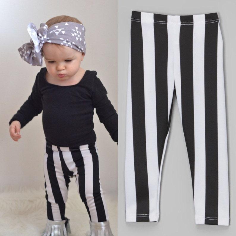 Dreaming Kids Black and Off White Stripe Leggings  Infant image 0