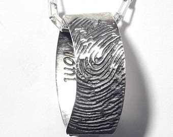 Silver pendant with fingerprint, memorial pendant, love pendant, apparently flattened ring with personalized text.