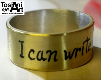 Ring with custom text in silver and brass.