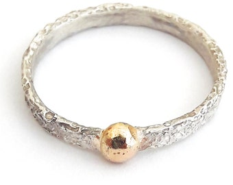 Sterling silver ring with 18 K gold drop, and personalized text.