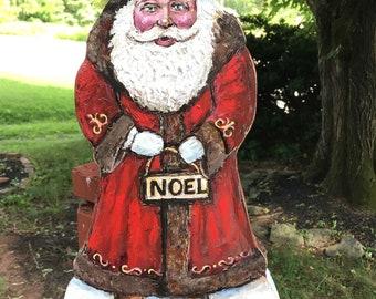 Santa with Noel sign