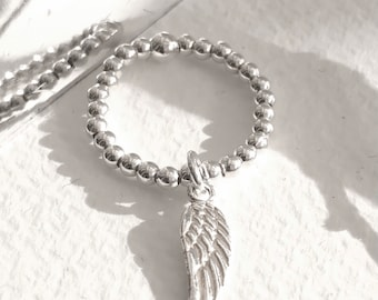 Angel wing ring, stretch ball ring, stacking ring, angel wing charm.