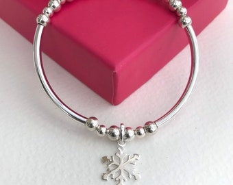 Silver stretch ball bracelet with noodle bead sides and snowflake charm, layering silver bracelet, handmade, birthday gift, 925 silver.