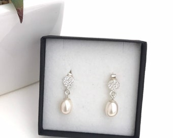 Pearl crystal drop earrings. Stunning round ivory white freshwater drop pearl earrings, cz pave set crystal setting, sterling silver.