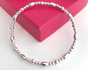 Silver ball bracelet, stretch stacking bracelet, 925 silver layering bracelet, birthday gift, oval and round bead elastic bracelet.