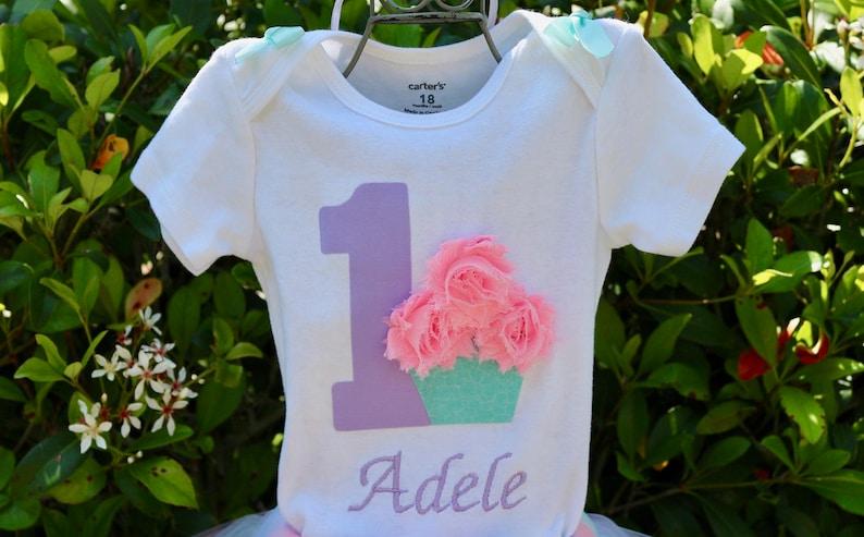 Light Pink Onesie or T-Shirt w Lavender Age Baby Girl 1st Birthday Outfit Lavender /& Aqua Ribbon Trim Tutu 3D Cupcake Headband Name