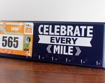 running: running medals displays with race bibs - running