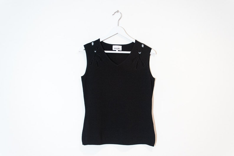 555e03f9021c92 On sale black beaded sleeveless knit top   fitted cutout