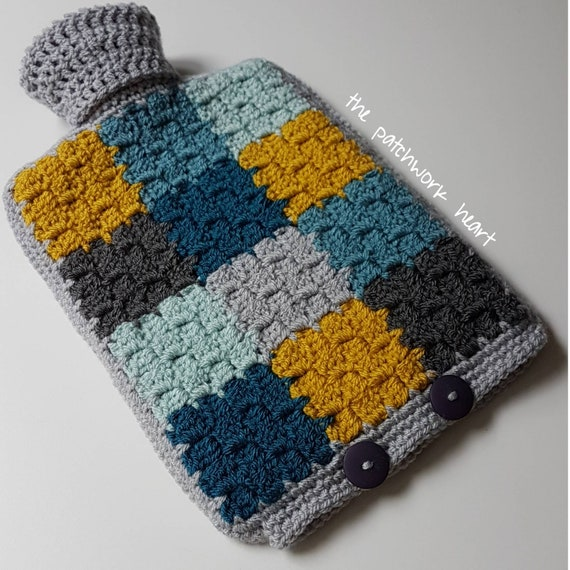 A Crocheted Hot Water Bottle Cover With A 2l Hot Water Bottle Etsy