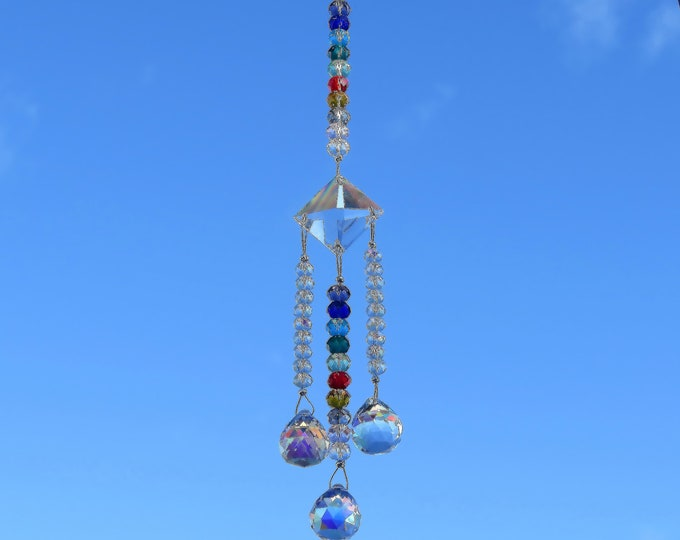 Rainbow Crystal/glass sun catcher to add sparkle to your patio or use it in a window to put color through out your room when the sun shines.