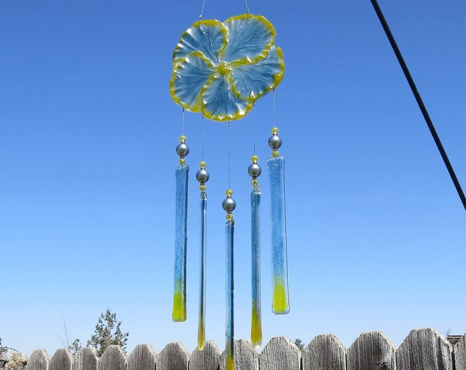 This Sea blue and Yellow Hibiscus flower wind chime will add that something special to your patio or yard