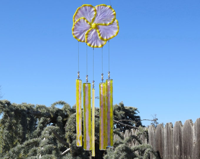 This yellow and purple Hibiscus flower wind chime will add that something special to your patio or yard