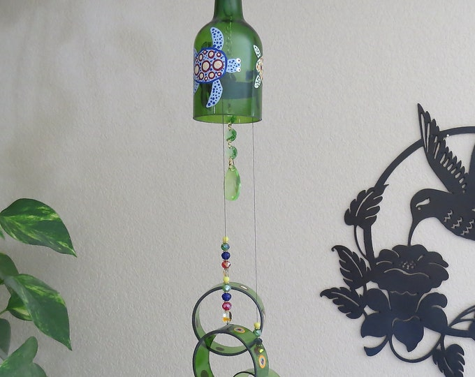 This wine bottle wind chime with it's fun turtles and poke-a-dots will add color and fun to your yard or patio