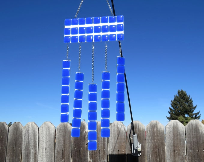 You will love this blue and white wind chime in your yard or garden!