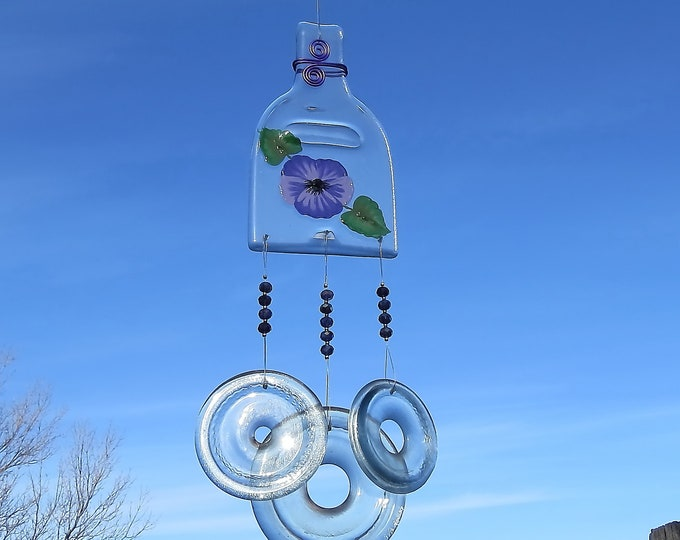 This wind chime with it's clear slumped bottle and rings makes a wonderful sound when there is the slightest breeze.