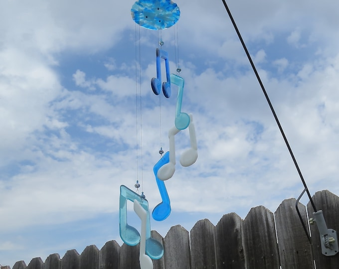 This Beautiful glass Music note  wind chime will look beautiful in your yard or garden