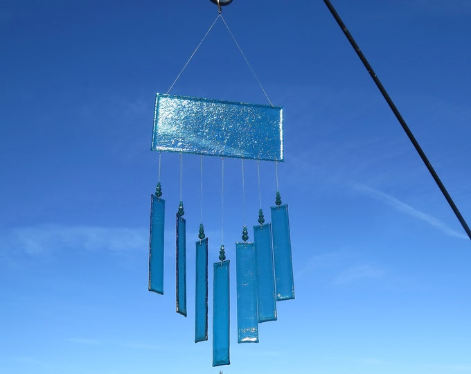 This Elegant wind chime will add beauty to any area of your yard or patio.  It will make the sweetest sound with just the slightest breeze.
