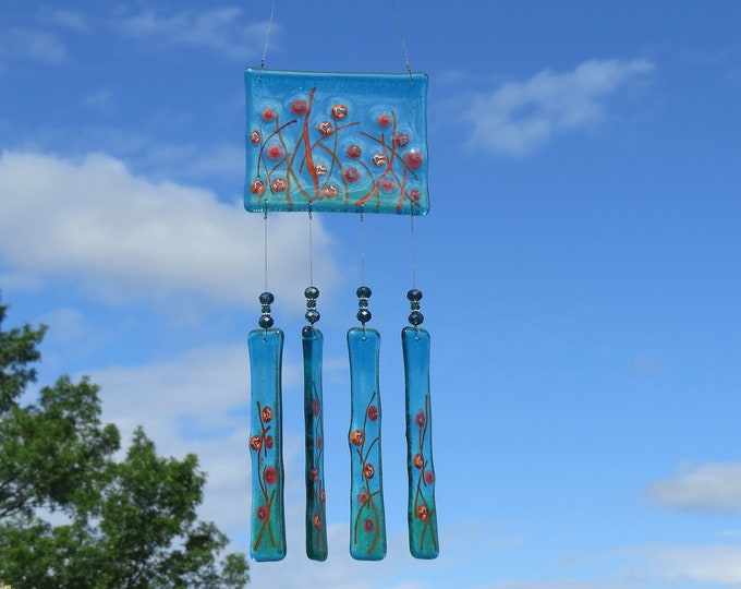 Wonderful Teal glass wind chime with Hearts will add beauty to your yard or garden