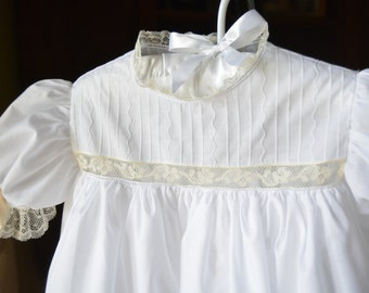 Serpentine Pin Tucked Square Yoked Dress