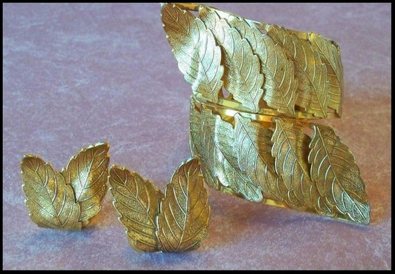 Vargas Gold Tone Leaves clamper bracelet and earrings