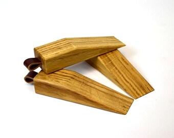 Oak and leather wedge doorstops