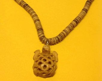 """Wood Necklace. Measures 18"""" Long With A 46 mm Wood Turtle."""