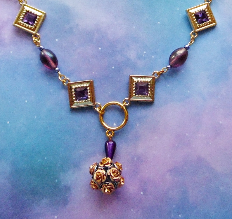 Purple and Goldtone Diamond Shaped Necklace with Rose Ball Bead