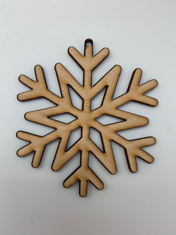 DIY Snowflake Ornaments.  Perfect Christmas craft for families.