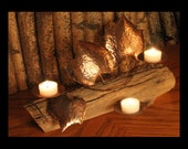 Driftwood-like grape vine candle holder with copper finish