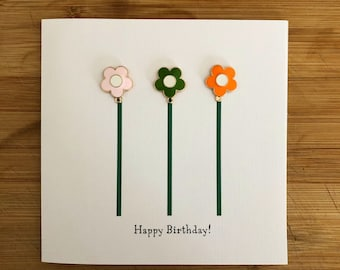 Happy Birthday card with three removable enamel flower charms that can be reused as jewellery accessories