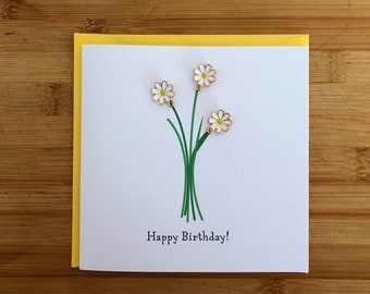 Daisy charm handmade birthday card with three enamel daisy charms that can be reused as jewellery acessories