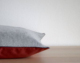 GREY AND RED Cushion cover. A decorative pillow made from cotton in grey jersey and red and blue ribbon