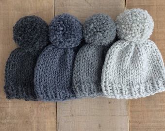 Baby pompom hat hand knitted in natural wool and alpaca yarn in a choice of black grey silver and neutral.  Perfect for baby boys and girls