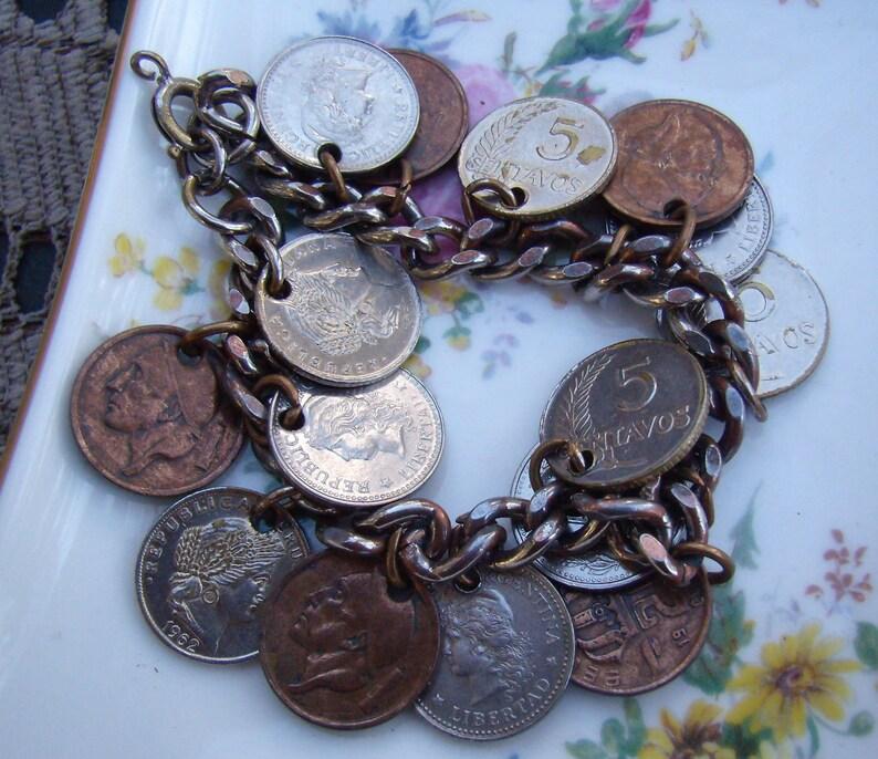 Summer Sale...Vintage Coin Bracelet....15 Coin Dangles...Argentina....Belgique...Peruana...Silver Metal Coin Charm Bracelet