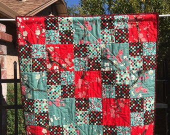 Aqua and red cherry blossoms wall hanging quilt