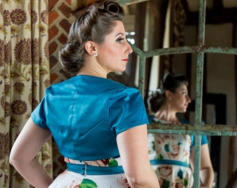 Teal bolero jacket, with a capped sleeve, fully lined. Made to order. Available in other colours.