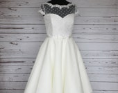 Ivory polka dot and tulle tea length 50s style wedding dress, with capped sleeves, floral trim and bow belt, made to order in UK sizes 6-24