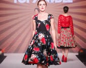 Size 10, 50s inspired red and black floral full circle occasion dress, with pockets. Capped sleeves and sweetheart neckline.