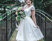 SALE Size 10. 50s inspired tea length ivory lace wedding dress, with gorgeous curved seaming bodice detail and lace capped sleeves