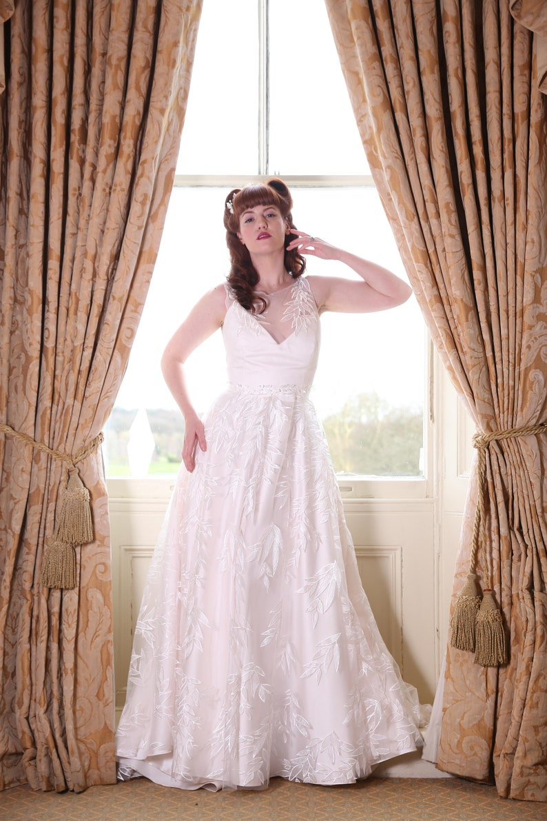 Ivory leaf tulle A-line wedding dress with covered button image 0