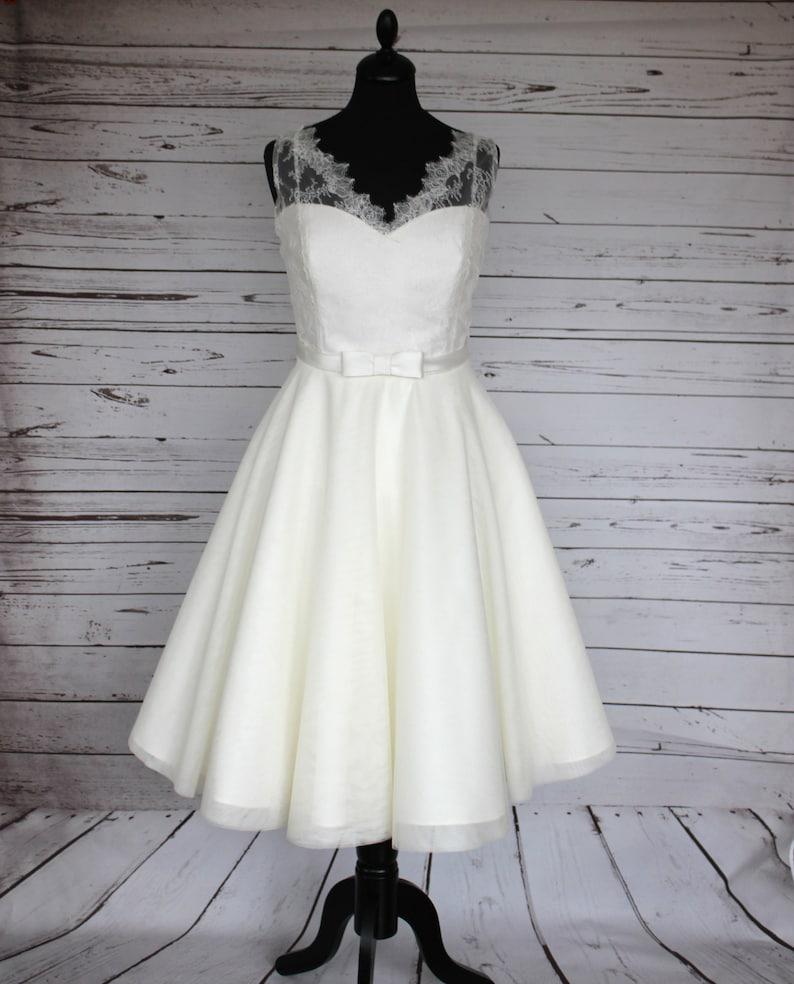 Ivory V-neck lace and tulle tea length 50s style wedding image 0